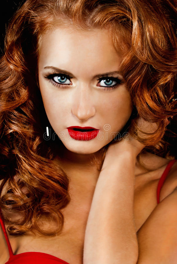 Free Beautiful, Daring Red-haired Girl In Red Dress Stock Photo - 25835220