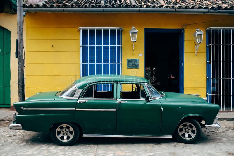 A beautiful classic car in Trinidad, Cuba. A beautiful dark green classic car parked in Trinidad, Cuba royalty free stock photography