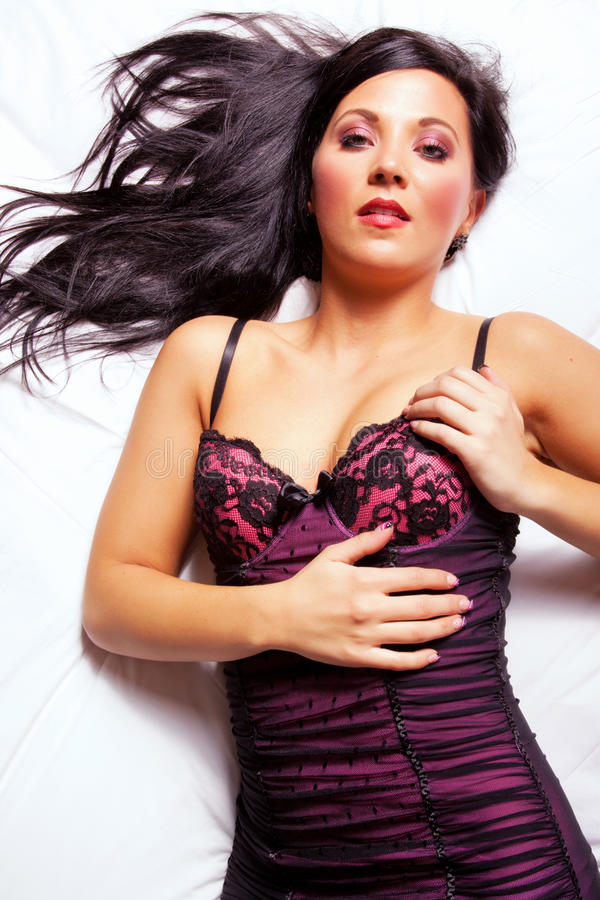 Download Beautiful Dark Hair Woman On The Bed Stock Image - Image: 18549685