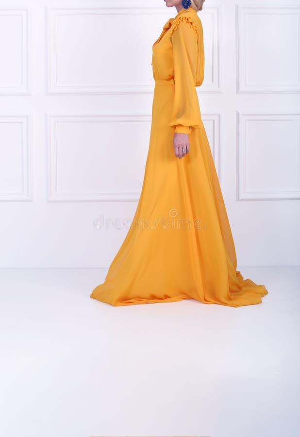 Beautiful dark orange dress stock photos