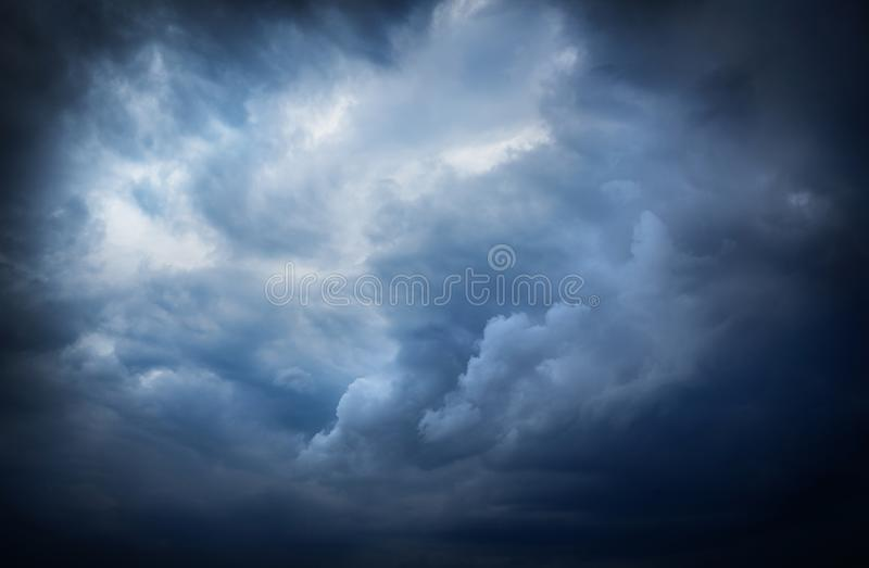 Beautiful dark storm sky with sun rays. royalty free stock photography