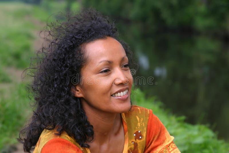 Beautiful dark woman stock photography
