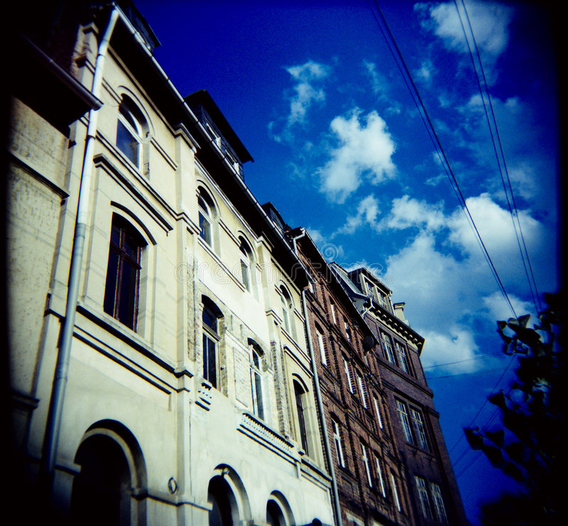 Beautiful day (lomo). Houses shot with a lomo (holga 120) - crossprocessed - visible grain stock images