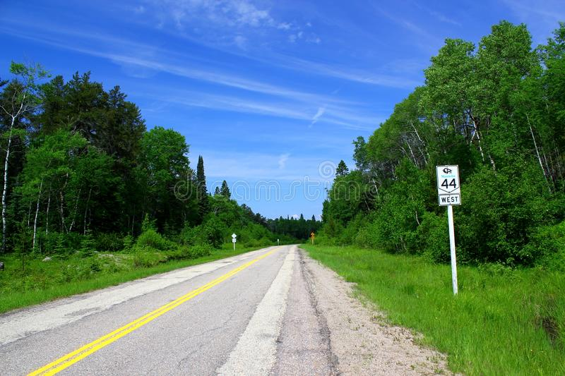 Beautiful day for a road trip: Scenic highway / Canada. Beautiful day for a road trip: Scenic highway near Lake Superior in Ontario / Canada royalty free stock photo