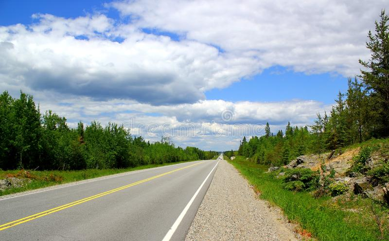 Beautiful day for a road trip: Scenic highway near Lake Superior in Ontario / Canada royalty free stock images