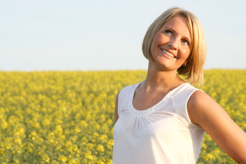 Beautiful Day - Summer time. A beautiful young woman and yellow flowers stock images