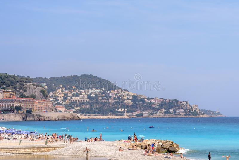 Beautiful daylight view to blue sea of Nice Cote d`Azur, France. NICE COTE D`AZUR, FRANCE - JUNE 27,2017: Beautiful daylight view to blue sea. People walking and royalty free stock photo