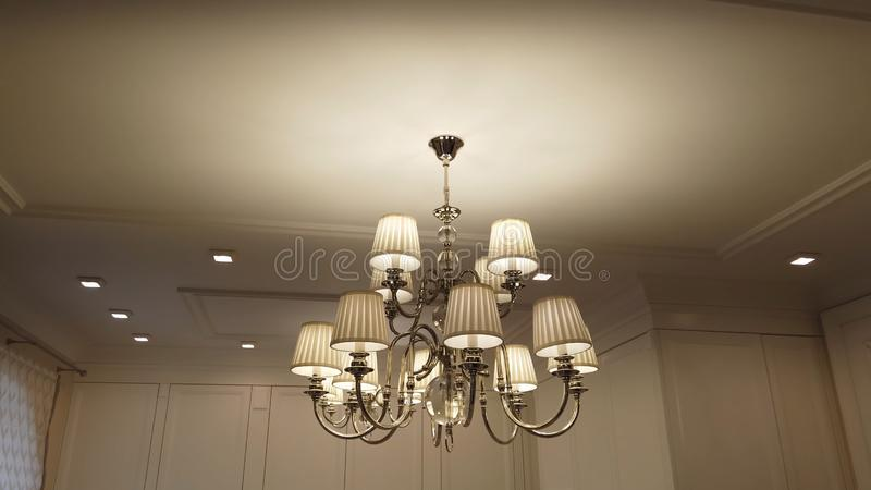 Beautiful and dear modern chandelier in living room. stock image