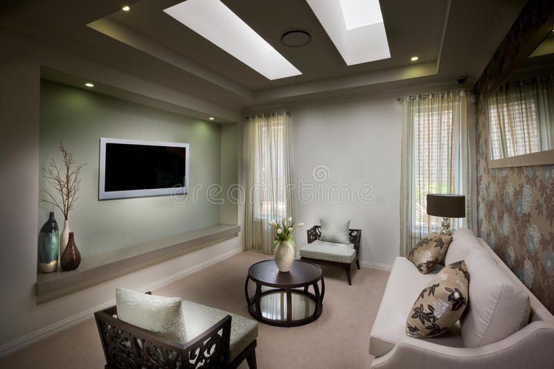 A Beautiful Decent Moody Living Room With A Tv Stock Image