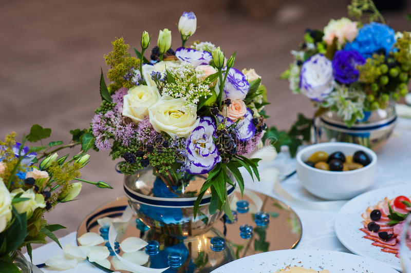 Beautiful decor of flowers on a wedding table in restaurant royalty free stock image