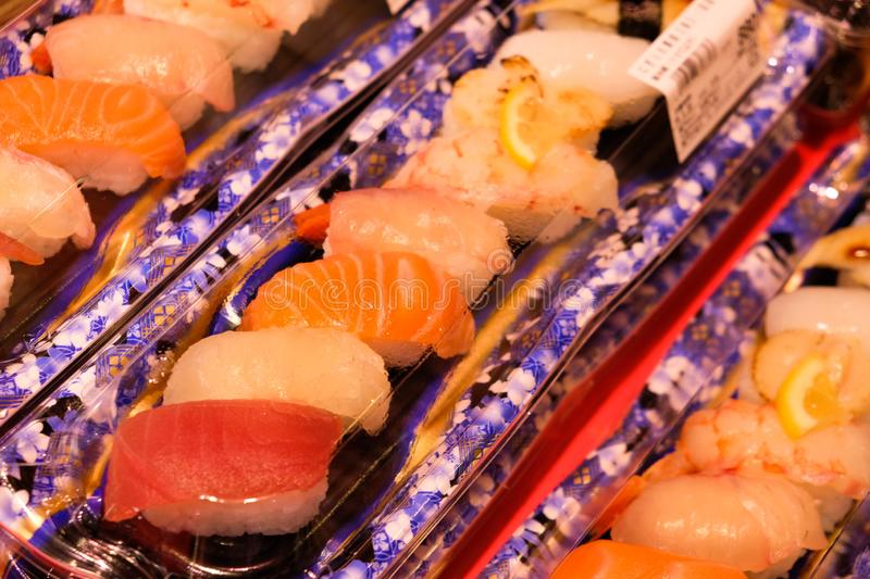 Beautiful decorated assorted raw fish sushi packed in a box containing tuna, salmon. Osaka, Japan - March 19 2019: Beautiful decorated assorted raw fish sushi stock images