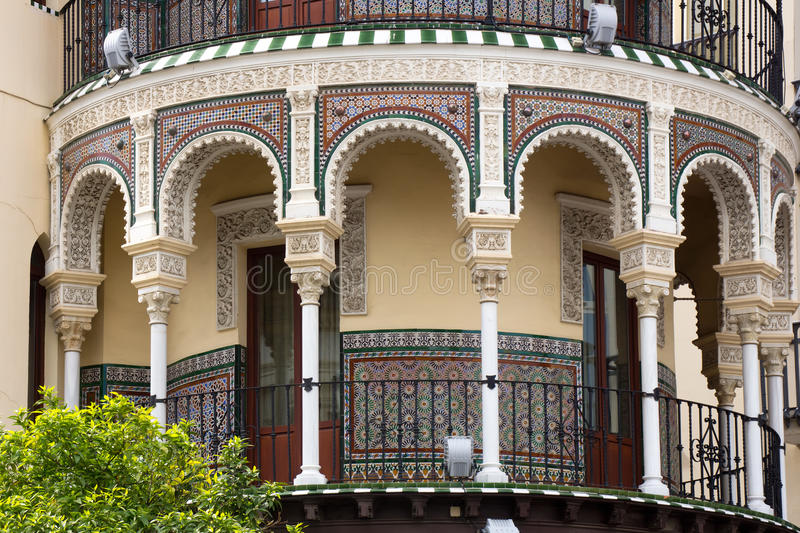 Beautiful decorated building in Seville. Beautiful decorated round building in Seville with arches and colorful tiles royalty free stock photos