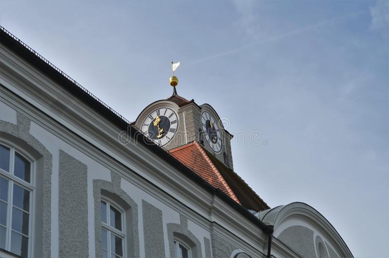 Beautiful decorated clock at Nymphenburg castle in Munich in Germany royalty free stock photo
