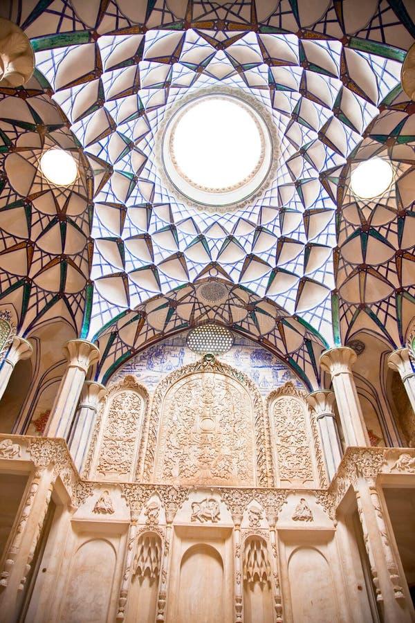 Beautiful decorated Dome of Khan-e Borujerdi. Historic house in Kashan, Iran royalty free stock photography