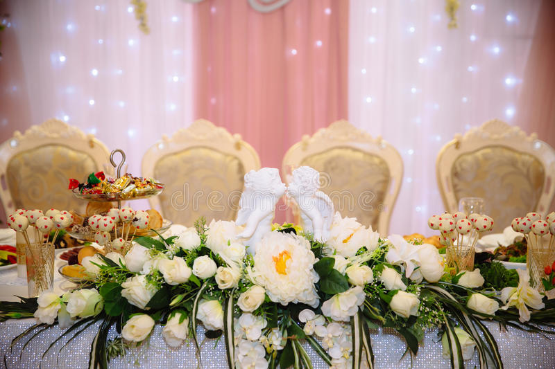 Beautiful decorated wedding restaurant for marriage. Colorful decoration for celebration. Beauty bridal interior. Concept of style of banquet hall stock photography