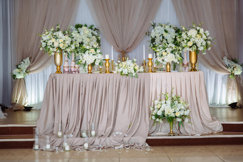 Beautiful decorated wedding restaurant for marriage. Colorful decoration for celebration. Beauty bridal interior. Concept of style of banquet hall royalty free stock photo