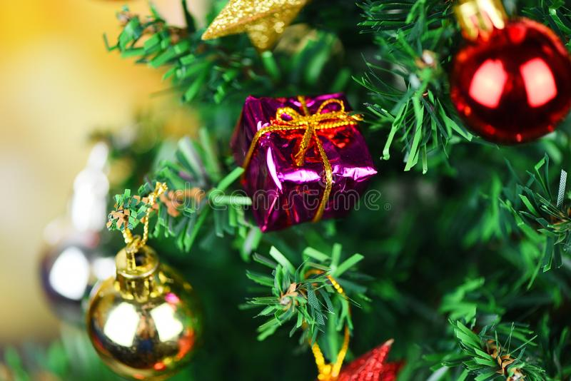 Beautiful decoration christmas tree on blurred colorful bokeh background - Christmas tree with ball gift box star and lights. Beautiful decoration christmas tree stock photography