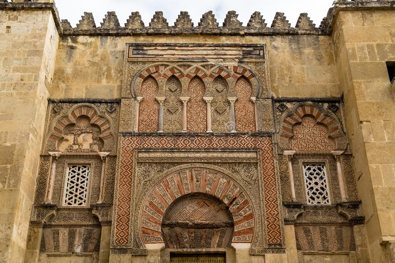 Beautiful decorations on the outside walls of Mezquita, Cordoba. Beautiful decorations on the outside walls of Mezquita, a former Moorish Mosque that is now the stock photo