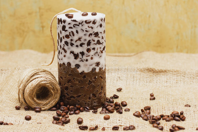Beautiful Decorative Handmade candle with coffee beans on old sa royalty free stock photo