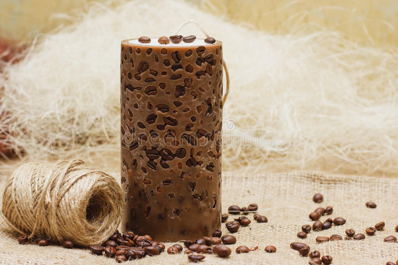 Beautiful Decorative Handmade candle with coffee beans on old sa stock photo