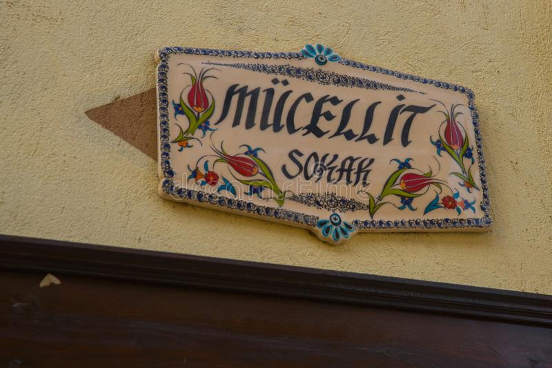 Beautiful decorative plate on the house with an ornament and the name. Historical Homes and street from Odunpazari. Eskisehir. Eskisehir is populer tourist stock photos