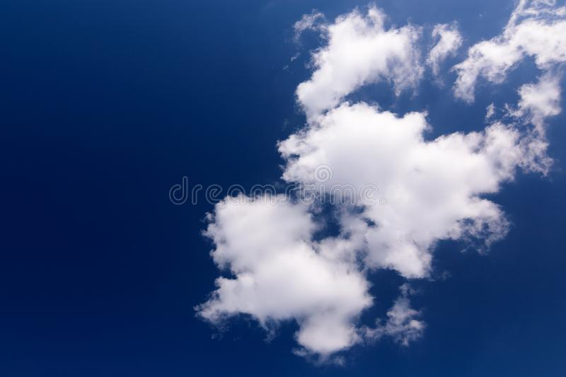 Beautiful deep blue sky with white puffy clouds on a sunny day.White Clouds on blue sky concept royalty free stock photo