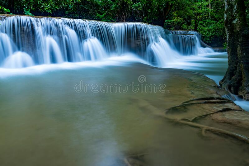 Beautiful deep forest waterfall in Thailand stock photography