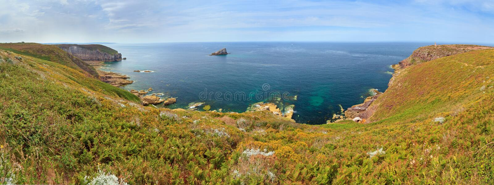 Cap Frehel panorama coast. Beautiful 180 degree panoramic view of the cliffs at Cap Fréhel in Brittany, France, with its lighthouses and moorland with vibrant royalty free stock photo