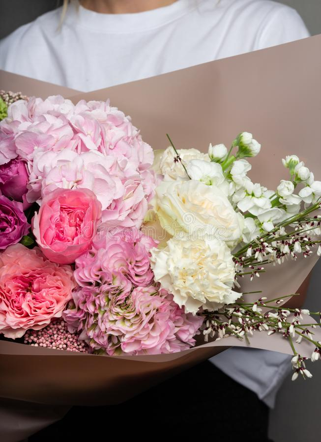 Beautiful delicate bouquet in hand, a bouquet of fresh flowers, handicraft royalty free stock images