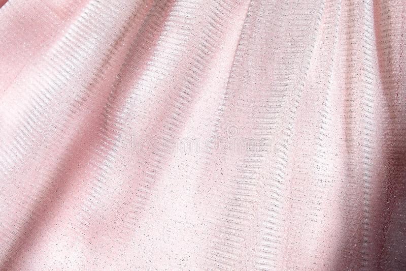 Beautiful delicate pink background. Shiny mesh fluffy fabric close-up texture.  stock image