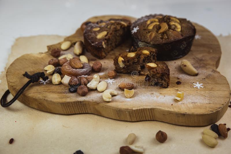 Beautiful delicious homemade Christmas dried fruit and nuts cake on wooden table stock photos