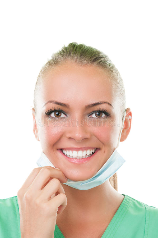 Beautiful dentist assistant with perfect smile royalty free stock image