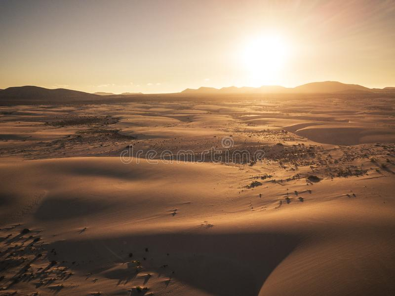 Beautiful desert and dunes view from above with sun and shadows on the sand - amazing nature outdoors and concept of beauty of the royalty free stock images