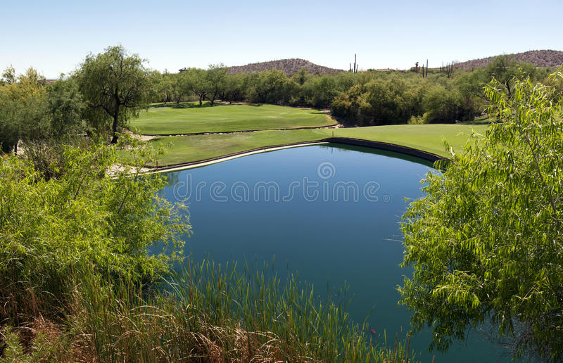 Beautiful desert golf course with lake. Beautifully groomed Arizona desert golf course with lake stock images