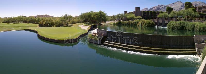 Beautiful desert golf resort with lake waterfall royalty free stock photo