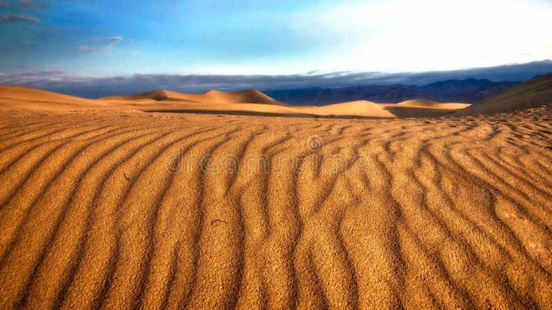 Beautiful desert hills with natural shapes carried by the wind in the Sahara royalty free stock image