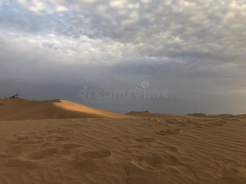 Beautiful   desert Sunset Grassland aaa. Travel, beautiful scenery, through the beautiful desert, grassland, seeing the sunset, people are embarrassed, the stock photography