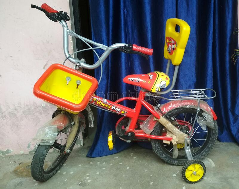 Beautiful design of kids bicycle in yellow, black and red colour. Gorakhpur city stock photography