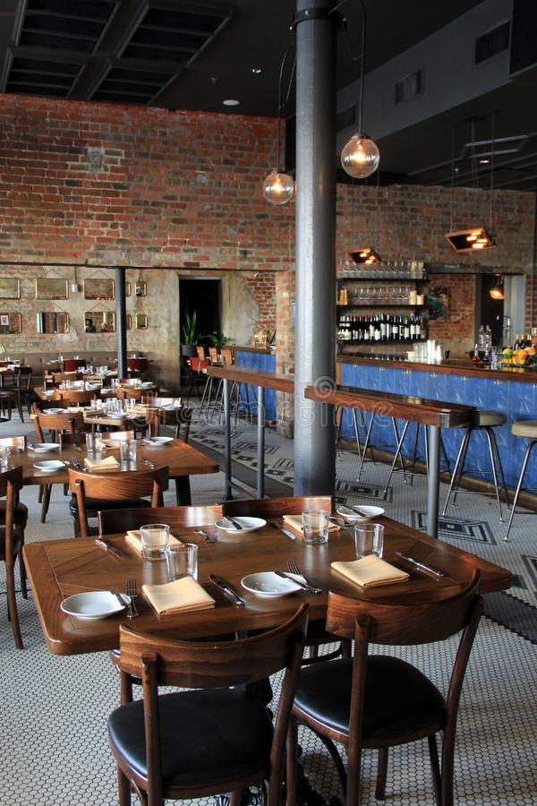 Interesting dining area in newly renovated restaurant and hotel, The Old 77 Hotel and Chandlery, New Orleans, 2016. Beautiful design with old brick walls and royalty free stock photo