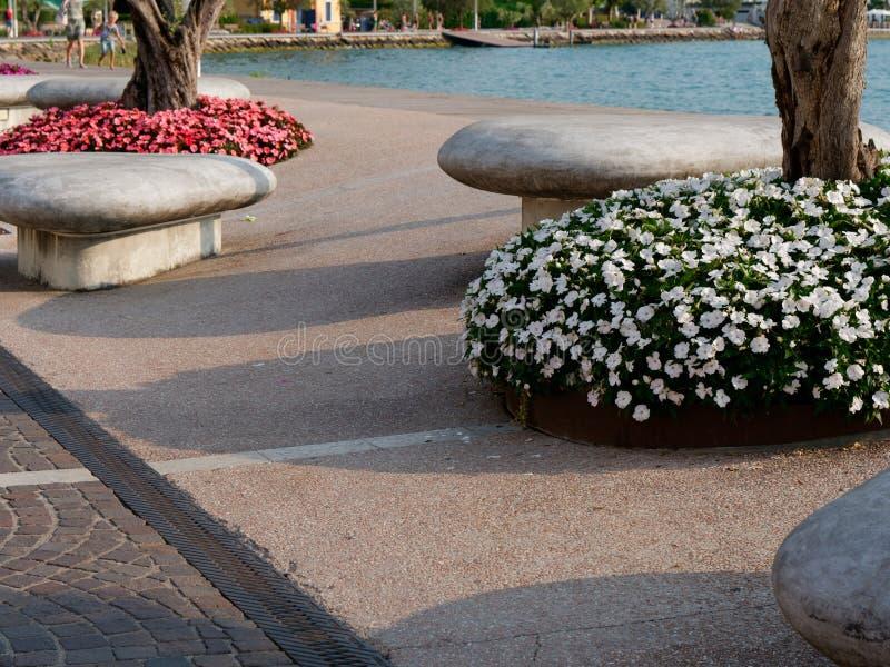 Beautiful designer benches on the promenade of Bordolino Italy. 2019 stock photo
