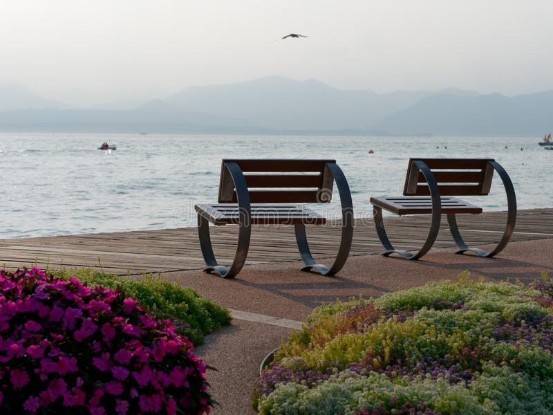 Beautiful designer benches on the promenade of Bordolino Italy. 2019 royalty free stock images