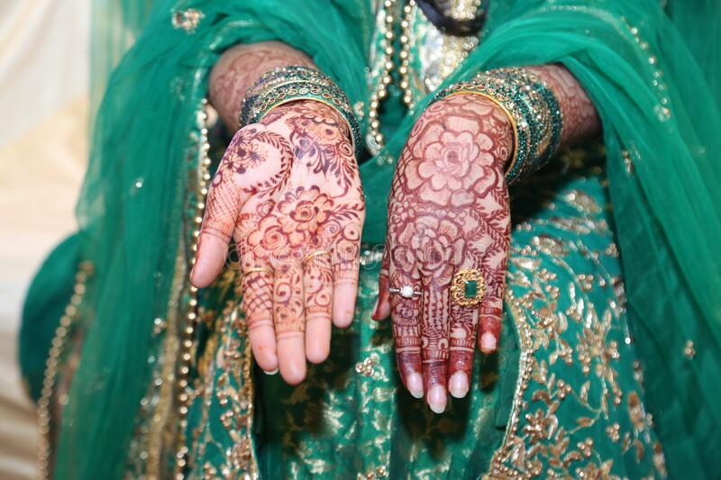 Mehndi Henna Designs on hands in Indian Tradition Weddings. Beautiful designs on hands using henna paste called as Mehndi which is done by women for any royalty free stock image