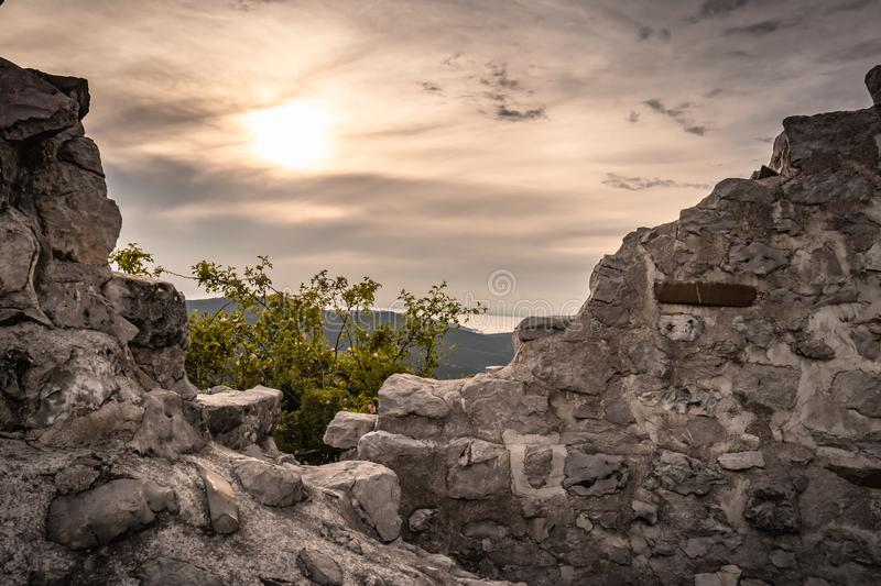 Beautiful detail close up view on cliff and castle fortress rocks on crni kal hill with direct sunlight, slovenia stock photography