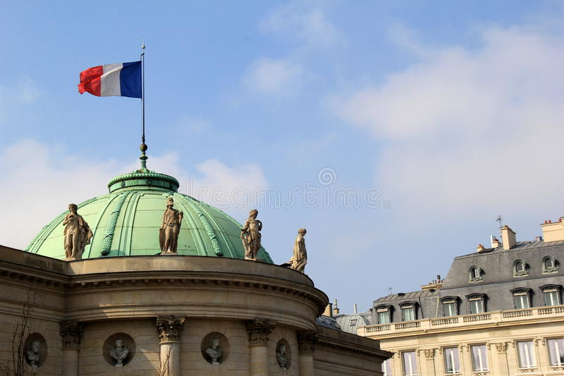 Beautiful detail in historic architecture with statues atop buildings, Paris,France,2016. Beautiful detail in different styles of historic architecture, with royalty free stock image
