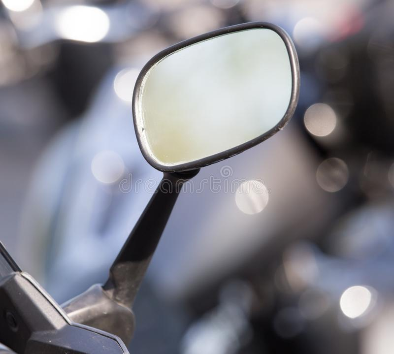 Beautiful detail of the motorcycle. mirror stock photography