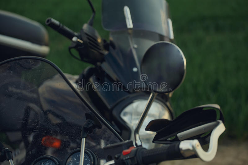 Beautiful detail of the motorcycle. mirror. reflection of blue sky and clouds royalty free stock image