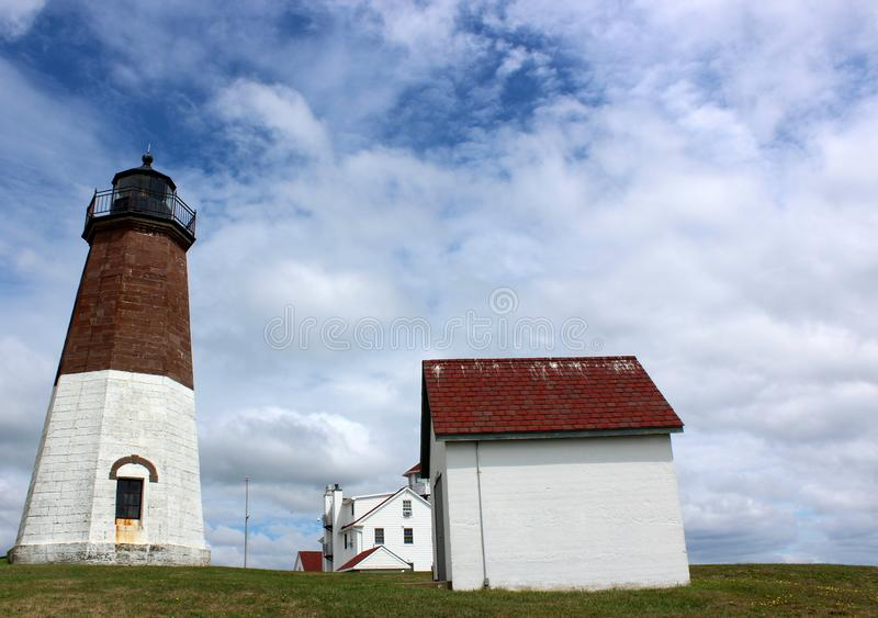 Welcoming scene of blue skies, puffy clouds and beloved lighthouse, Point Judith, Rhode Island, 2018 royalty free stock photos