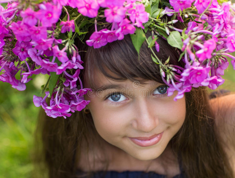 Beautiful girl with a wreath of flowers royalty free stock photography