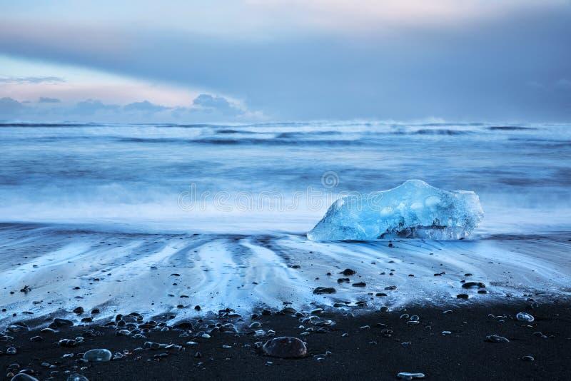 Beautiful Diamond beach. Iceland, famous black beach with icebergs also known as Diamond beach, Jokulsarlon glacier lagoon, beautiful evening landscape in stock photos