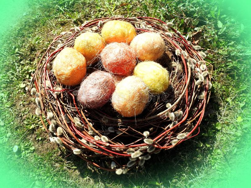 Colorful Easter Eggs in wicker, Lithuania royalty free stock photography